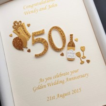Anniversary cut out number gold