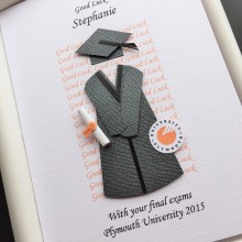 Graduation gown and mortar good luck