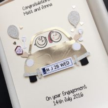 Engagement couple in car with simple embellishments