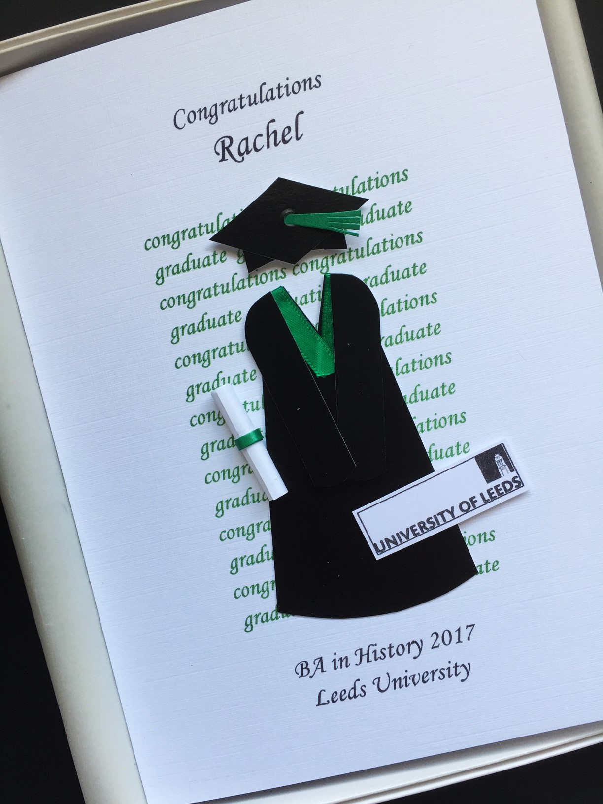 Graduation Gown And Mortar With University Logo Example Leeds